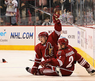 Scottie Upshall celebrates his first career hat trick with teammate Jim Vandermeer. (Getty Images)