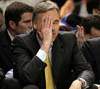 Knicks coach Mike D'Antoni has seen better days, barely able to watch his team lose by 50 points.  (AP)