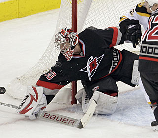 Cam Ward makes one of his 27 saves to pick up his 131st win to set the team mark.  (AP)