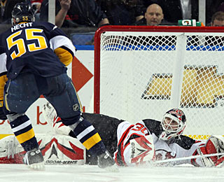 Jochen Hecht goes right to left and beats Martin Brodeur with the first goal in the SO. (US Presswire)
