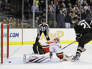 Loui Eriksson uses a swift backhander to put the puck past Miikka Kiprusoff for the winner. (AP)