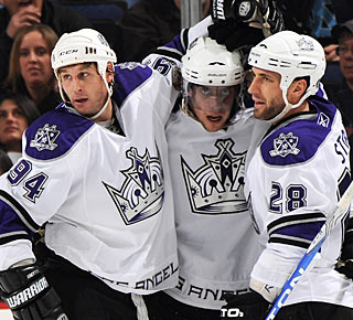 Anze Kopitar (center) gets cheers after scoring his second goal (career No. 101). (Getty Images)