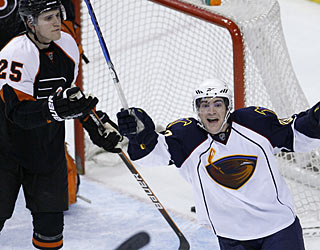 While Jim Slater celebrates his winning goal, Matt Carle (25) seems to ask what just happened. (AP)