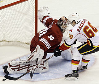 Ilya Bryzgalov denies Mikael Backlund in the shootout to earn his career-best 28th win. (AP)