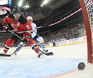 Zach Parise scores the first of his two goals in the first period. (Getty Images)