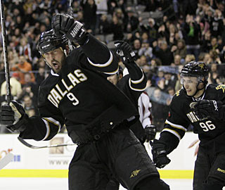 Mike Modano scores two goals in a game for the first time this season and has four in four games. (AP)