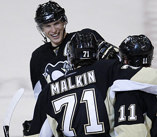 Goals by Sidney Crosby and Evgeni Malkin help the Penguins improve to 7-0 in shootouts.  (AP)