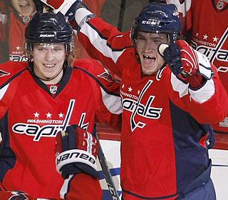 Alex Ovechkin (right) enjoys the go-ahead goal as the Capitals run their win streak to 10 games.  (AP)