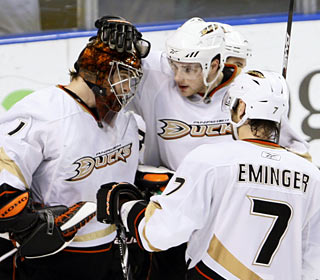 Goalie Jonas Hiller provides immediate dividends in his first game since signing a four-year extension.  (AP)