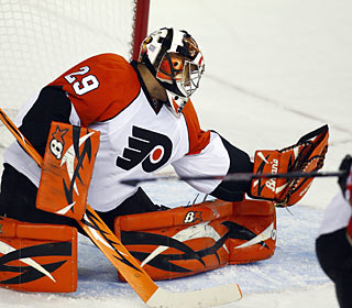 The Flames can't penetrate the Flyers' goal as Ray Emery achieves his third shutout of the season.  (AP)