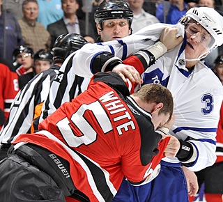 Dion Phaneuf has a physical debut with Toronto, landing hits and fighting Colin White. (Getty Images)