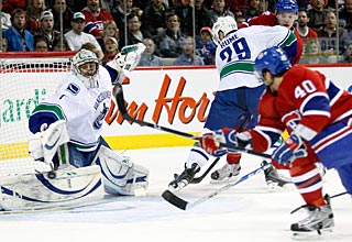 Maxim Lapierre (40) gets to a loose rebound to drive the puck into an open side. (Getty Images)