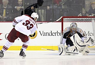 Adrian Aucoin seals the deal for the Coyotes with this wrister past Pekka Rinne. (AP)