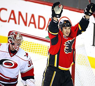 Curtis Glencross celebrates his first goal before eventually enjoying a three-goal night. (AP)