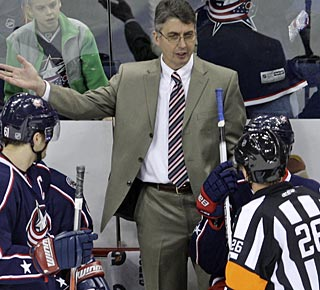 Claude Noel steps into his role right away and begins his NHL coaching career with a victory. (AP)