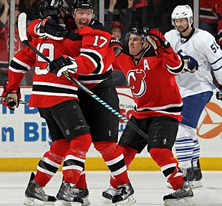 Ilya Kovalchuk (17) and his new teammates celebrate what is an impressive comeback. (Getty Images)