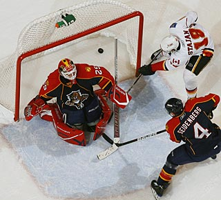 Matt Stajan looks for the rebound, but Ales Kotalik's (not pictured) shot is in the net. (Getty Images)