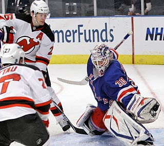 The Devils pepper shots at New York's Henrik Lundqvist all game but only one goes in.  (AP)