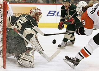 Anton Khudobin turns away a good scoring chance by Scott Hartnell for one of his 38 saves. (AP)