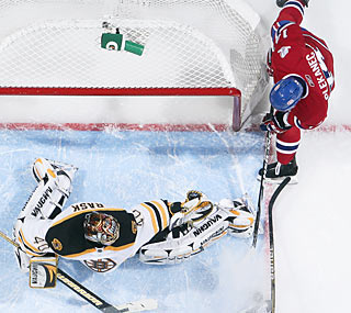 Goalie Tuukka Rask turns away a Tomas Plekanec shot for one of his 36 blocks in the shutout.  (Getty Images)