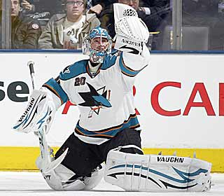 Evgeni Nabokov survives a late flourish by the Maple Leafs to ice a Sharks win. (Getty Images)