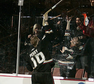 Corey Perry (goal, two assists) creates havoc with his stick before awarding it to a lucky fan.  (Getty Images)