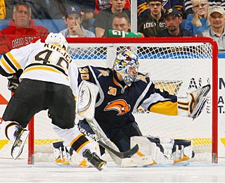 David Krejci wrists the winner past Ryan Miller in the third round of the shootout. (Getty Images)