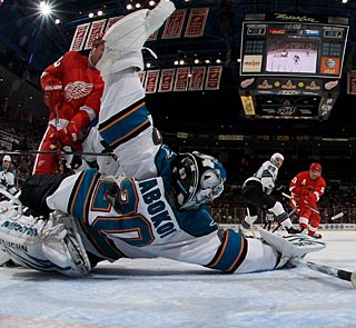 Evgeni Nabokov practically stands on his head to make a spectacular blocker save. (Getty Images)