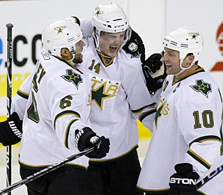 Jamie Benn (center), fourth among NHL rookies with 14 goals, celebrates his game-winner.  (AP)