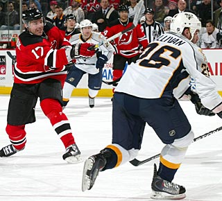 Ilya Kovalchuk fires and scores his first goal since coming to New Jersey. (Getty Images)