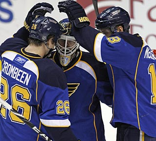 Blues players congratulate goalie Chris Mason for his solid outing and second shutout this season. (AP)
