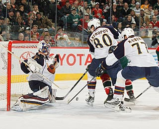 Johan Hedberg makes 36 saves to help Atlanta beat Minnesota for the first time in nine meetings. (AP)