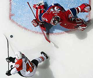 Daniel Briere goes backhand past Carey Price to ice a hat trick. (Getty Images)