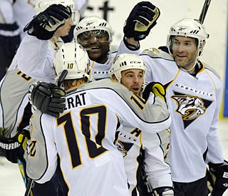 Martin Erat (10) gets team hugs after scoring the shootout winner.  (AP)
