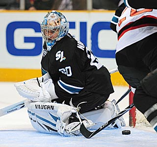 San Jose's Evgeni Nabokov reacts too late to a loose puck before the Devils knock it home.  (US Presswire)