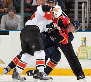 David Booth does it all. He scores a goal, sets up three others and also fights Mike Richards. (Getty Images)