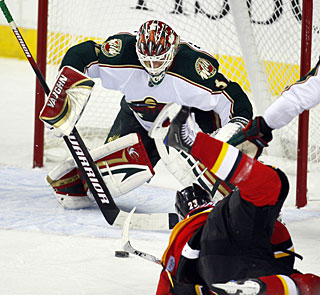 Niklas Backstrom takes the matchup with Finland teammate Miikka Kiprusoff at the other end. (AP)