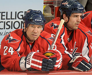 Scott Walker gets a little rest on the bench after scoring two goals in his first game. (Getty Images)
