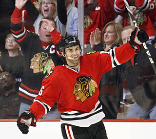 Andrew Ladd completes a hat trick in the third period, but it isn't enough to save the Blackhawks.  (AP)