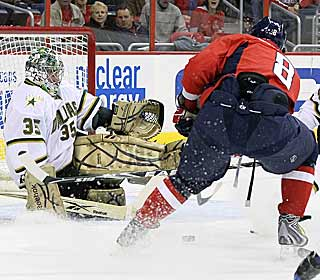 Alex Ovechkin slides in two goals but Marty Turco comes up big when it counts.  (Getty Images)