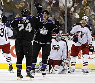 Alexander Frolov caps off a productive first period by scoring the Kings' second power-play goal. (AP)