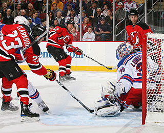 Brian Rolston (12) fires a shot from the dot and beats Henrik Lundqvist through the legs. (Getty Images)