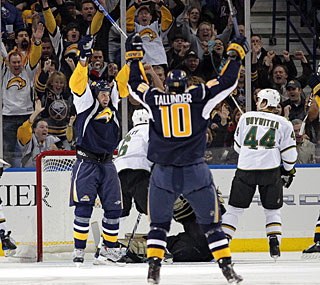 Tyler Myers (left) gets a tip-in for his ninth goal and also contributes to three more tallies. (US Presswire)