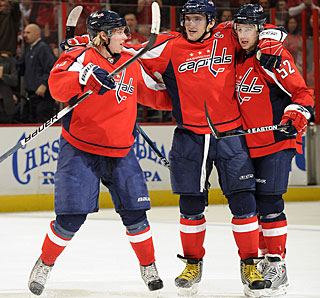 Mike Green (52) celebrates his second-period goal with Alex Ovechkin and Nicklas Backstrom. (Getty Images)
