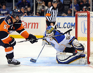 Chris Mason helps the Blues with 29 stops and also denies Frans Nielsen in the shootout. (US Presswire)