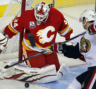 Nothing gets past Miikka Kiprusoff, who stops 33 shots for his fourth shutout this season. (AP)