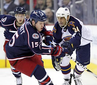 Chris Chelios (right) fails to keep the puck in the zone, leading to a Blue Jackets goal.  (AP)