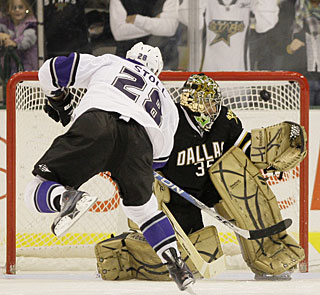 Jerret Stoll beats Marty Turco top shelf for the decisive goal in the shootout. (AP)