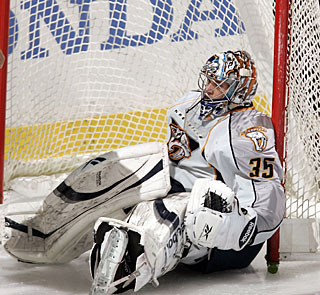 Pekka Rinne gets knocked into the net, but not the puck as he earns his fourth shutout. (Getty Images)