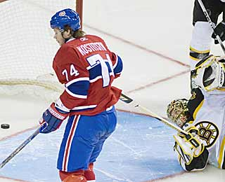 All Tuukka Rask can do is look back as Sergei Kostitsyn's goal crosses over the line. (AP)